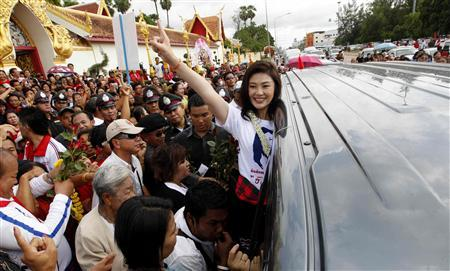 Yingluck Shinawatra, sister of toppled premier Thaksin Shinawatra and the prime ministerial candidate for the country's biggest opposition Pheu Thai Party, greets her supporters during an election campaign in Nakhon Phanom province, east of Bangkok June 7, 2011. Thai political parties have started campaigning across the country ahead of a general election scheduled for July 3. REUTERS/Sukree Sukplang