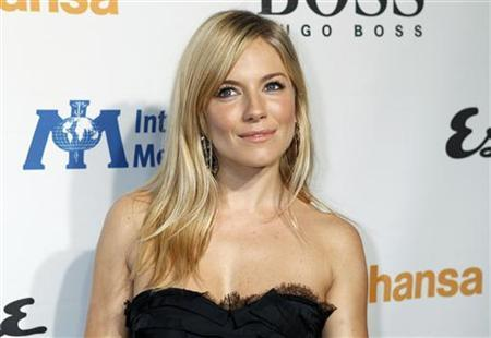 Actress Sienna Miller poses at the Esquire House LA grand opening benefit for the International Medical Corps in Los Angeles, California October 15, 2010. REUTERS/Fred Prouser