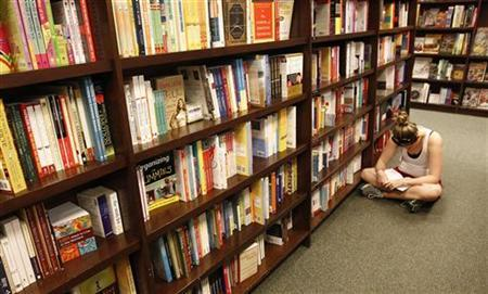 A girl reads in an aisle at a Barnes and Noble bookstore in Falls Church, Virginia, August 24, 2010. REUTERS/Kevin Lamarque