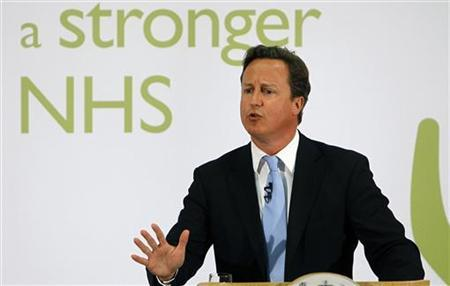 Britain's Prime Minister David Cameron gestures as he speaks about National Health Service (NHS) reforms, at University College Hospital in London June 7, 2011. REUTERS/Alastair Grant/Pool