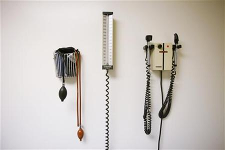 Devices used to take blood pressure, temperature, and examine eyes and ears rest on a wall inside of a doctor's office in New York in this March 22, 2010 file photo. REUTERS/Lucas Jackson