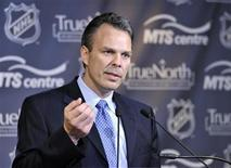 <p>Kevin Cheveldayoff speaks with the media after being introduced as the general manager of Winnipeg's NHL franchise in Winnipeg, June 8, 2011. REUTERS/Fred Greenslade</p>