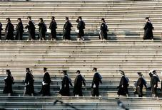 <p>In this file photo graduating students enter the Paladin stadium during the commencement ceremony at Furman University in Greenville, South Carolina May 31, 2008. REUTERS/Larry Downing</p>