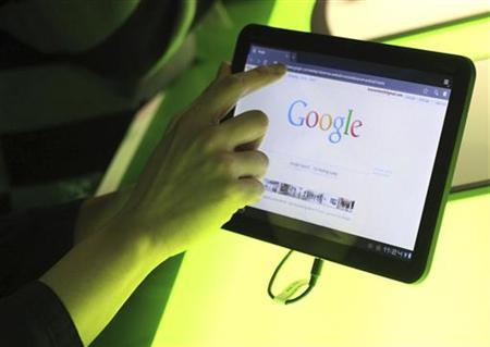The Google home page is shown on Google's latest version of the Android operating system, Honeycomb, on a Motorola Xoom tablet device following a news conference at Google Headquarters in Mountain View, California February 2, 2011. REUTERS/Beck Diefenbach