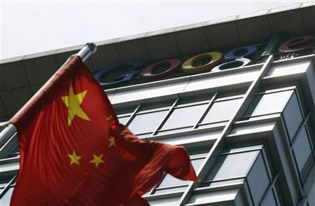 A Chinese national flag waves in front of the former headquarters of Google China in Beijing June 2, 2011. REUTERS/Jason Lee