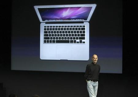 Apple CEO Steve Jobs unveils the company's latest thinner MacBook Air during a news conference at Apple Inc. headquarters in Cupertino, California October 20, 2010. REUTERS/Norbert von der Groeben