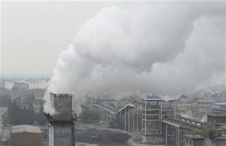Smoke billows from a chimney at a coking factory in Hefei, Anhui province October 2, 2010. REUTERS/Stringer
