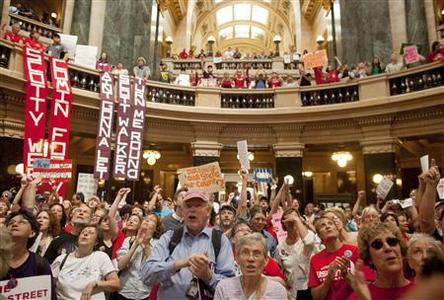 Protesters return to occupy the state Capitol June 14, 2011 as the Wisconsin State Assembly takes up the budget bill that was proposed from Wisconsin Republican Governor Scott Walker in Madison. REUTERS/Darren Hauck