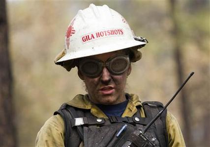 A wildland firefighter works at a hot spot on the eastern edge of the Wallow Wildfire outside Alpine, Arizona near the state border west of the town of Luna, New Mexico June 14, 2011. REUTERS/Jim Urquhart