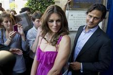 <p>British model Elizabeth Hurley (L) and her husband, Indian businessman Arun Nayar leave after the Valentino fashion house Fall/Winter 2010-2011 Haute Couture show in Paris July 7, 2010. REUTERS/Gonzalo Fuentes</p>