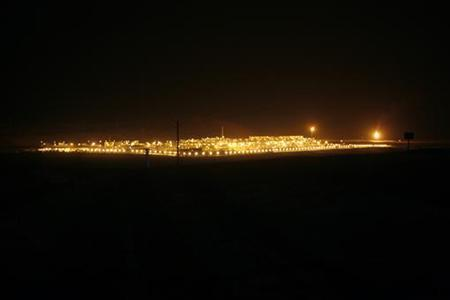 Shaybah oilfield complex is seen at night in the Rub' al-Khali desert, Saudi Arabia, November 14, 2007. REUTERS/Ali Jarekji