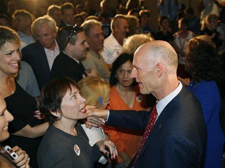 Florida Republican gubernatorial candidate Rick Scott (R) greets a supporter after his victory rally in Ft Lauderdale, Florida, November 3, 2010. REUTERS/Andrew Innerarity