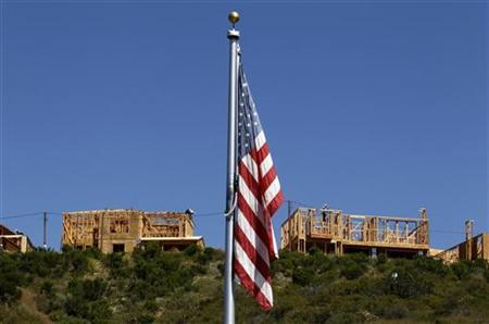 Workers build new homes on a hilltop in Carlsbad, California, May 27, 2011. REUTERS/Mike Blake