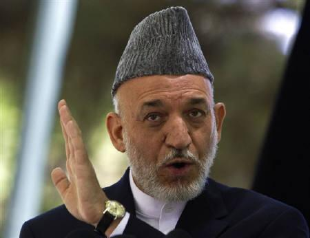 Afghanistan's President Hamid Karzai gestures as he speaks during a news conference in Kabul May 31, 2011. REUTERS/Ahmad Masood/Files