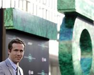 """<p>Cast member Ryan Reynolds poses at the premiere of """"Green Lantern"""" at the Grauman's Chinese theatre in Hollywood, California June 15, 2011. REUTERS/Mario Anzuoni</p>"""