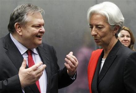 Greece's Finance Minister Evangelos Venizelos talks to France's Finance Minister Christine Lagarde during an eurozone finance ministers meeting in Luxembourg, June 19, 2011. REUTERS/Francois Lenoir
