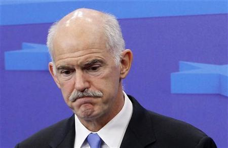 Greece's Prime Minister George Papandreou talks to the media after a meeting at the EU Council in Brussels, June 20, 2011. REUTERS/Thierry Roge