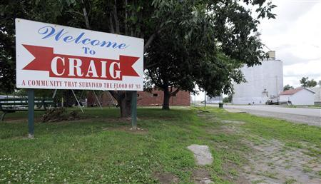 A welcome sign to Craig, Missouri states that it survived the large flooding in 1993, but is projected to be covered in flood waters as the town of 300 performs a mandatory evacuation in Craig, Missouri. June 21, 2011. REUTERS/Dave Kaup