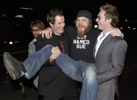 Steven Green (L), the director of ''Gumball 3000 - The Movie,'' cast member Ryan Dunn (C) and Maximillion Cooper, who launched ''Gumball 3000'' in 1999, ham it up for photographers during the premiere of the film at Grauman's Chinese Theatre in the Hollywood section of Los Angeles February 19, 2004. REUTERS/Jim Ruymen
