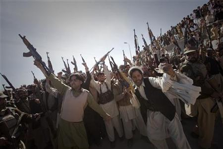 Members of the local Lashka (tribal militia-men), hold their weapons while dancing in a show-of-force in Khar, the main town in Bajaur Agency, located in Pakistan's Federally Administered Tribal Areas (FATA) along the Afghanistan border March 2, 2010. REUTERS/Adrees Latif