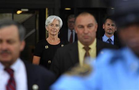 France's Minister of Economy Christine Lagarde (2nd L) is escorted as she departs after a day of meetings ahead of her interview to potentially be the next managing director of the International Monetary Fund, at IMF headquarters in Washington, June 22, 2011. REUTERS/Jonathan Ernst