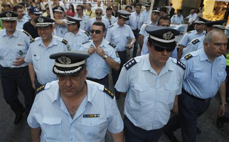 Police officers march during a rally against a new austerity package in Athens, June 23, 2011. REUTERS/John Kolesidis