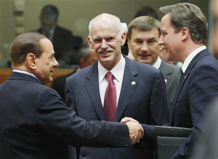 Prime ministers, Italy's Silvio Berlusconi (L), Greece's George Papandreou (C) and Britain's David Cameron chat at the start of an European Union leaders summit in Brussels June 23, 2011. REUTERS/Thierry Roge