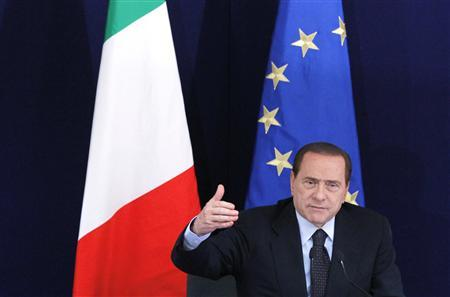 Italy's Prime Minister Silvio Berlusconi addresses a news conference during an European Union leaders summit in Brussels June 24, 2011. REUTERS/Francois Lenoir
