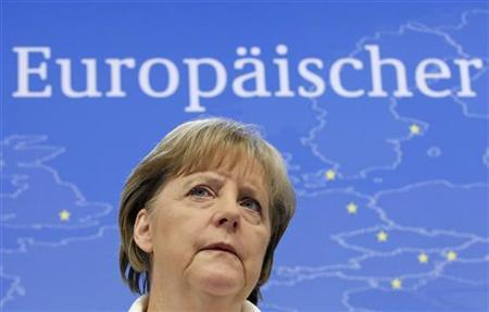 Germany's Chancellor Angela Merkel addresses a news conference at the end of an European Union leaders summit in Brussels June 24, 2011. REUTERS/Thierry Roge