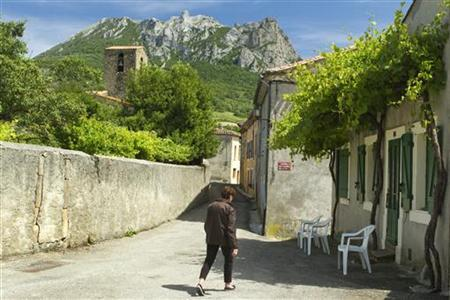 The village and Peak of Bugarach, the highest point of the Corbieres massif, in southwestern France, is seen June 24, 2011. REUTERS/Jean-Philippe Arles