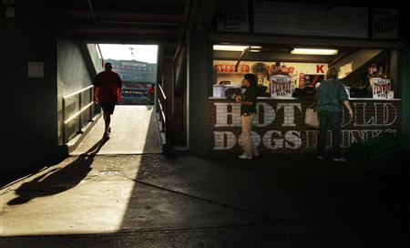 Workers prepare before a game at Fenway Park in Boston, September 8, 2010. REUTERS/Brian Snyder