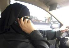<p>Umm Ibrahim sits behind the wheel of her vehicle as she drives in Riyadh, an act that is banned in Saudi Arabia June 21, 2011. REUTERS/Amena Bakr</p>