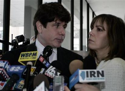 Former Illinois Governor Rod Blagojevich (L) looks at his wife Patti before they leave the Dirksen Federal building after being convicted on 17 of 20 counts in his second corruption trial in Chicago, Illinois June 27, 2011. REUTERS/Frank Polich