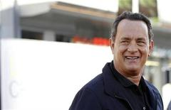 "<p>Director and cast member Tom Hanks poses at the world premiere of ""Larry Crowne"" at the Chinese theatre in Hollywood, California June 27, 2011. REUTERS/Mario Anzuoni</p>"