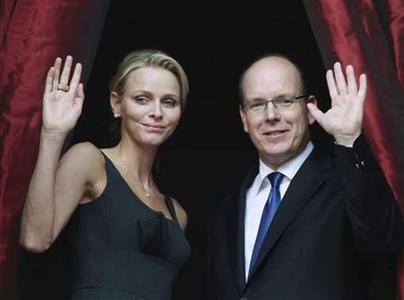 Monaco's Prince Albert II and his fiancee Charlene Wittstock wave as they attend the Saint Jean procession in Monaco, June 23, 2011. REUTERS/Eric Gaillard