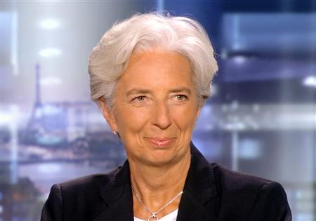 France's Finance Minister Christine Lagarde reacts after the announcement that she was selected as the new IMF chief, at the TF1 television studios in Boulogne-Billancourt, near Paris June 28, 2011. REUTERS/TF1