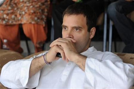 Rahul Gandhi, a lawmaker and the son of India's ruling Congress party chief Sonia Gandhi, watches the ICC Cricket World Cup semi-final match between India and Pakistan in Mohali March 30, 2011. REUTERS/Raveendran/Pool