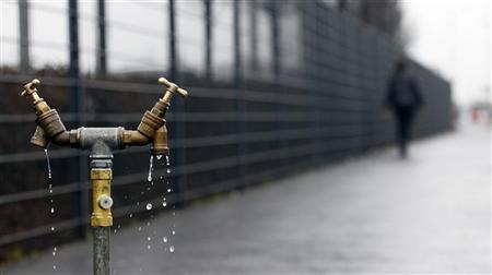Water drips from a standing pipe on Boucher Road in Belfast, Northern Ireland December 30, 2010. REUTERS/Cathal McNaughton