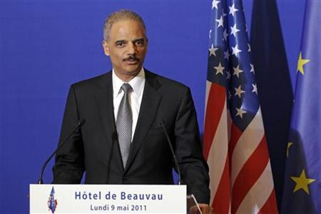 U.S. Attorney General Eric Holder attends a press conference at the Interior Ministry in Paris on May 9, 2011. REUTERS/Benoit Tessier