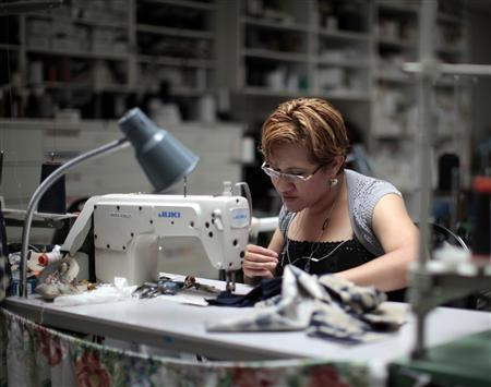 Worker Maria Robles sews clothes at the Karen Kane clothing company in Los Angeles, June 30, 2011. The apparel industry in Los Angeles is riding a small but growing wave of ''insourcing'' as costs in China and India rise and the city's factories cater to demand for high-quality garb and fast-turn fashion. REUTERS/Lucy Nicholson
