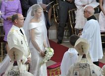 <p>Monaco's Prince Albert II (L) and Princess Charlene stand at the altar in front of a priest during their religious wedding ceremony at the Palace in Monaco July 2, 2011. REUTERS/Bruno Bebert/Pool</p>