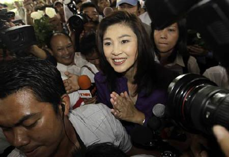 Yingluck Shinawatra, sister of ousted premier Thaksin Shinawatra, smiles as she arrives to her party's headquarters after voting in the general election in Bangkok July 3, 2011.  REUTERS/Damir Sagolj