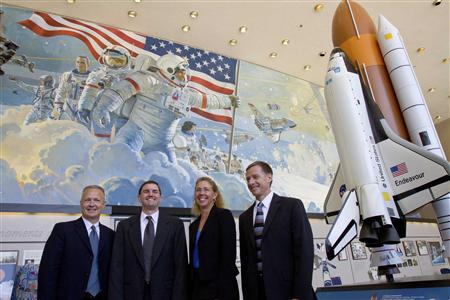 Space Shuttle Atlantis astronauts (L-R) Pilot Doug Hurley, mission specialists Rex Walheim and Sandy Magnus and Commander Chris Ferguson pose for a picture after a crew news conference at the Johnson Space Center in Houston June 30, 2011. REUTERS/Richard Carson TRANSPORT)