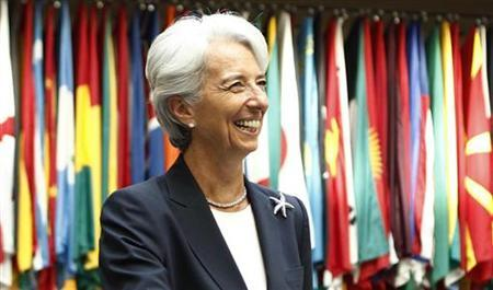 Former French Finance Minister Christine Lagarde smiles as she arrives at the International Monetary Fund headquarters for her first day as head of the IMF in Washington July 5, 2011. REUTERS/Kevin Lamarque