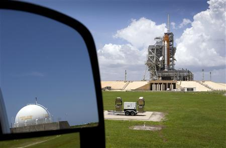 Space shuttle Atlantis STS-135 sits on launch pad 39A as it is prepared for launch at the Kennedy Space Center in Cape Canaveral, Florida July 5, 2011. REUTERS/Scott Audette