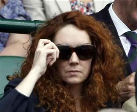 Rebekah Brooks, chief executive of News International, watching play on Centre Court at the Wimbledon tennis championships in London, July 1, 2011. REUTERS/Stefan Wermuth