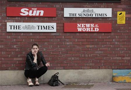 A woman speaks on her mobile phone outside the News International HQ building, in east London July 6, 2011. REUTERS/Olivia Harris