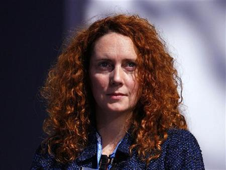Chief Executive of News International, Rebekah Brooks, listens to speeches during the Conservative Party conference in Manchester, northern England in this October 6, 2009, file photo. REUTERS/Phil Noble