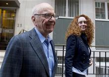 <p>News Corporation CEO Rupert Murdoch leaves his flat with Rebekah Brooks, Chief Executive of News International, in central London July 10, 2011. REUTERS/Olivia Harris</p>