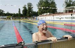 <p>Arthur Figur of the U.S. reacts after a swimming event during the 13th European Maccabi games at the Stadionbad open air pool in Vienna, July 8, 2011. REUTERS/Herwig Prammer</p>